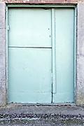 old metal plate covered doors