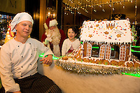 Amelia  Mannion (3)   with Santa and Chef Peter Major who designed a mouth - watering Gingerbread House, currently on display in the hotels elegant lobby that will be delivered to the hospital on Christmas Eve as a special delight for children & their families who regrettably have to spend the holiday season in hospital.  Photo:Andrew Downes