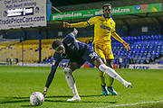 AFC Wimbledon forward Zach Robinson (29) challenges Southend United defender Richard Taylor (30) during the EFL Trophy match between Southend United and AFC Wimbledon at Roots Hall, Southend, England on 13 November 2019.