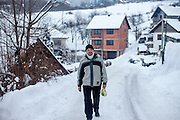 Former refugee Elvis Causevic walking up the mountain to the  families house in Hadžići. They settled here with his family after the war ended in Bosnia. Hadžići is a town and a municipality located about 20 km south west of Sarajevo city but within the Sarajevo Canton of Bosnia and Herzegovina. According to the census of 2013, Hadžići municipality has a population of 23,891 residents.