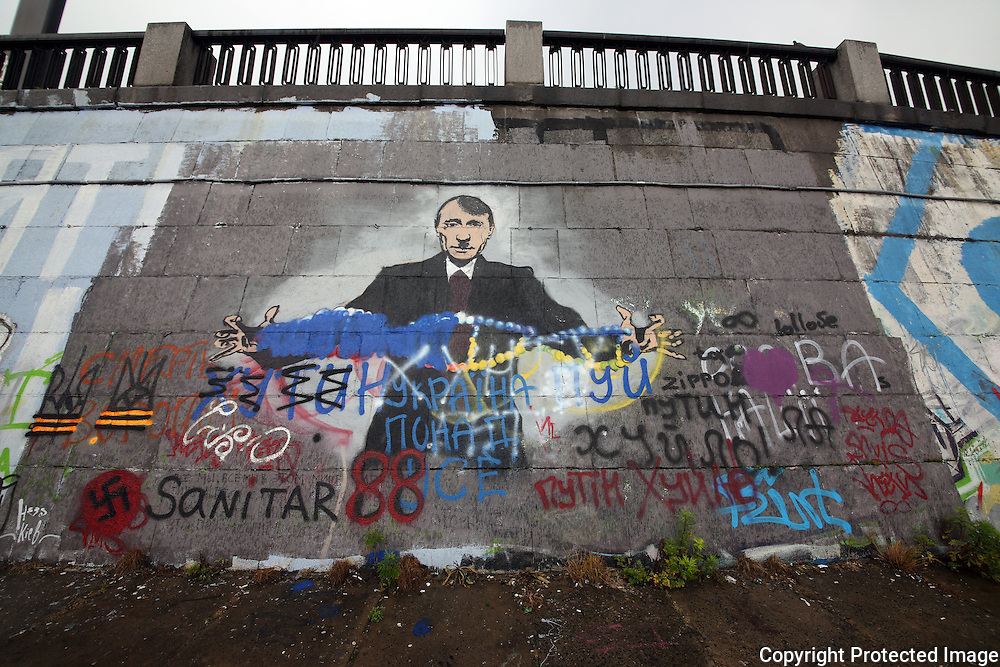 Ukraine Diary: Bohdan Warchomij Wednesday 22 May 2014 Graffiti near Dnipro Metro Station. Graffiti depicting Russian President Vladimir Putin as Adolph Hitler toying with Ukraine. ON the banks of the Dnipro River Photo Bohdan Warchomij
