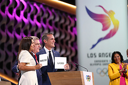 LIMA, Sept. 14, 2017  International Olympic Committee President Thomas Bach (C) hugs with Anne Hidalgo (L), Mayor of Paris, and Eric Garcetti, Mayor of Los Angeles, after announcement during the presentation and announcement ceremony of the 2024 and 2028 Summer Olympic Games at the 131st IOC session in Lima, Peru, on Sept. 13, 2017. The IOC makes historic decision by simultaneously awarding Olympic Games 2024 to Paris and 2028 to Los Angeles on wednesday. (Credit Image: © Li Ming/Xinhua via ZUMA Wire)