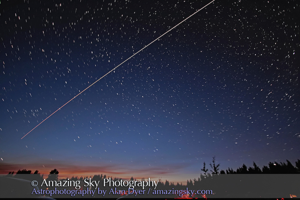 Pass of Space Station with Space Shuttle attached (STS118, with Dave Williams and Barbara Morgan aboard), taken Saturday, August 11, 2007 from Cypress Hills, Saskatchewan, from site of Saskatchewan Summer Star Party. Composite of ten 15-second exposures at 1-second intervals at ISO1600 and f/3.5 with 10mm lens on Canon 20Da camera, stacked with Lighten mode in Photoshop, and with 1-sec gaps in ISS trail filled in with cutting and pasting trail image from previous layer. Shows ISS/Shuttle approaching and brightening as it nears, and also climbs above atmospheric extinction caused by forest fire smoke from Montana fires.