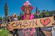 A Jeremy Corbyn fan - A day after the election result protestors gather to ask for Theresa May to quit and not do a deal with the DUP. Who people fear because of their views on abrtion, gay marriage etc. Westminster, London, 10 Jun 2017