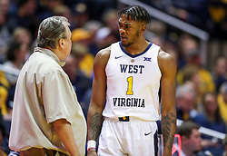 Dec 30, 2018; Morgantown, WV, USA; West Virginia Mountaineers forward Derek Culver (1) talks with West Virginia Mountaineers head coach Bob Huggins during the second half against the Lehigh Mountain Hawks at WVU Coliseum. Mandatory Credit: Ben Queen-USA TODAY Sports