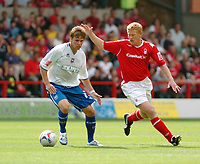 Photo: Leigh Quinnell.<br /> Nottingham Forest v Brighton & Hove Albion. Coca Cola League 1. 19/08/2006. Brightons Dean Hammond is watched by Forests Gary Holt.