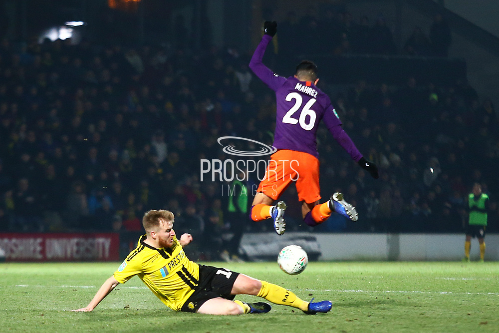 Burton Albion defender Damien McCrory (14) tackles Manchester City's Riyad Mahrez (26) during the EFL Cup semi final second leg match between Burton Albion and Manchester City at the Pirelli Stadium, Burton upon Trent, England on 23 January 2019.