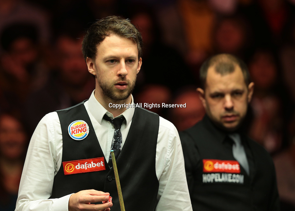 16.01.2016.  Alexandra Palace, London, England. Masters Snooker. Semi Finals. Barry Hawkins misses a red and looks on as Judd Trump comes to the table
