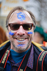 17 Feb 2015. New Orleans, Louisiana.<br /> Fat Tuesday. Mardi Gras Day. Faces in the crowd. Gerald Herbert having fun whilst working hard! <br /> Photo; Charlie Varley/varleypix.com