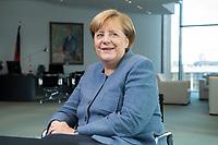 09 OCT 2017, BERLIN/GERMANY:<br /> Angela Merkel, CDU, Bundeskanzlerin, waehrend einem Interview, in ihrem Buero, Bundeskanzleramt<br /> IMAGE: 20171009-01-004<br /> KEYWORDS: B&uuml;ro, freundlich, lacht, lachen