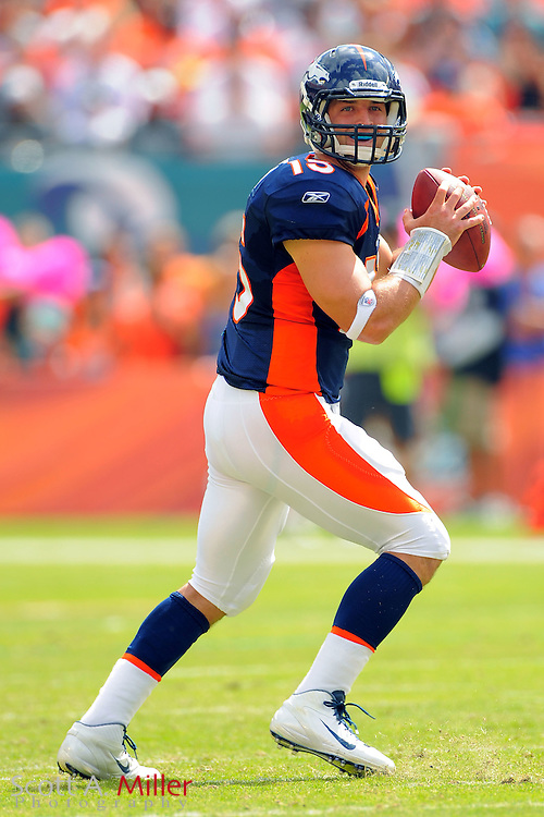 Denver Broncos quarterback Tim Tebow (15) looks to throw during the Broncos 18-15 overtime win against the Miami Dolphins at Sunlife Stadium on Oct. 22, 2011 in Miami Gardens, Fla.  .©2011 Scott A. Miller