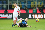 Aleksandar Kolarov of AS Roma is tackled by Marcelo Brozovic of Inter during the Italian championship Serie A football match between FC Internazionale and AS Roma on January 21, 2018 at Giuseppe Meazza stadium in Milan, Italy - Photo Morgese - Rossini / ProSportsImages / DPPI