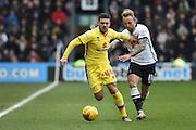 MK Dons forward Jake Forster-Caskey    battles with Derby County striker Johnny Russell during the Sky Bet Championship match between Derby County and Milton Keynes Dons at the iPro Stadium, Derby, England on 13 February 2016. Photo by Jon Hobley.