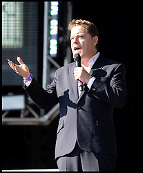 Eddie Izzard on stage at the Celebration of the 2012 Olympic Games volunteering one year on at the  Queen Elizabeth Olympic Park.<br /> Mayor of London Boris Johnson and Lord Coe will be taking to the stage at Go Local to encourage a new drive in volunteering one year on from the Games. Also present are multi-platinum selling pop rock band McFly; world famous comedian Eddie Izzard, Brit Award nominated The Feeling, and Britain'Got Talent winners Attraction, in addition to stars Jack Carroll and Gabz. The event will be the UKs biggest ever celebration of volunteering and first Olympic and Paralympic legacy event at Queen Elizabeth Olympic Park.<br /> London, United Kingdom<br /> Friday, 19th July 2013<br /> Picture by Andrew Parsons / i-Images