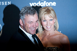 © Licensed to London News Pictures. 06/02/2012. London, UK. Golfer Darren Clarke and guest  arriving on the red carpet for the Laureus World Sports Awards 2012. Dozens of sports and Hollywood celebrities arrived in the English capital to attend the event held at the Queen Elizabeth II Conference Centre in the same year that London will host the Olympic Games. Photo credit : Ben Cawthra/LNP