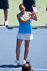 July 31, 2011; Stanford, CA, USA;  Marion Bartoli (FRA) holds up the runners-up trophy after her match against Serena Williams (USA), not pictured, during the finals of the Bank of the West Classic women's tennis tournament at the Taube Family Tennis Stadium. Williams defeated Bartoli 7-5, 6-1.
