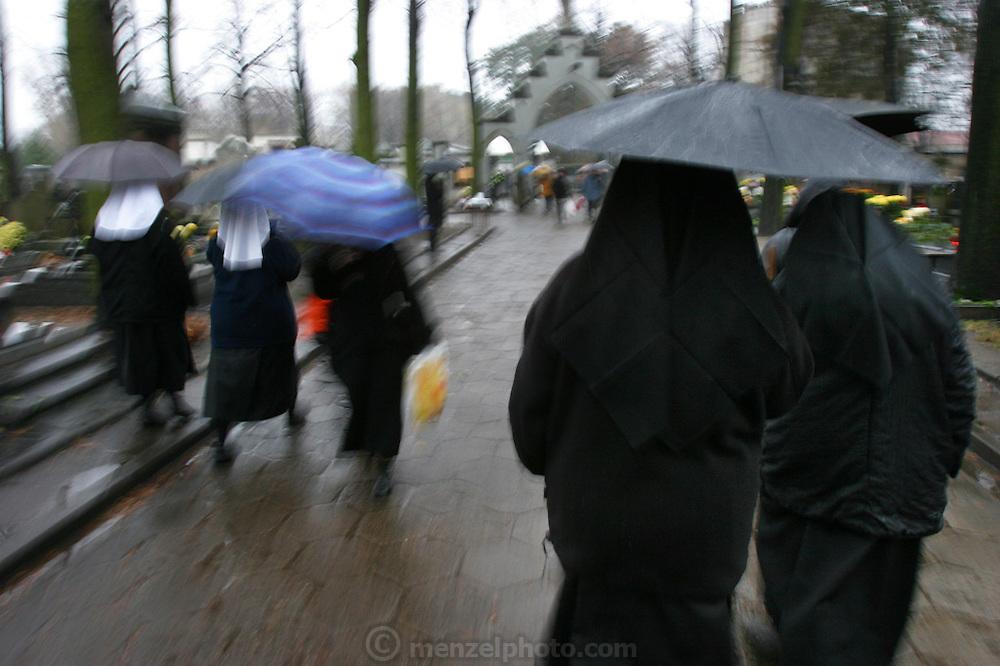 Nuns on the run, Lodz, Poland cemetery on All Saints Day.