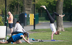 © Licensed to London News Pictures. 12/04/2020. London, UK. People exercising in Paddington Recreation Ground in London on Easter Sunday, during a pandemic outbreak of the Coronavirus COVID-19 disease. The public have been told they can only leave their homes when absolutely essential, in an attempt to fight the spread of coronavirus COVID-19 disease. Photo credit: Ben Cawthra/LNP