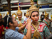 18 NOVEMBER 2015 - BANGKOK, THAILAND:  People in traditional Thai outfits in the procession marking the start of the temple's annual fair. Wat Saket is on a man-made hill in the historic section of Bangkok. The temple has golden spire that is 260 feet high which was the highest point in Bangkok for more than 100 years. The temple construction began in the 1800s in the reign of King Rama III and was completed in the reign of King Rama IV. The annual temple fair is held on the 12th lunar month, for nine days around the November full moon. During the fair a red cloth (reminiscent of a monk's robe) is placed around the Golden Mount while the temple grounds hosts Thai traditional theatre, food stalls and traditional shows.     PHOTO BY JACK KURTZ