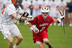 Maryland Terrapins Midfielder Dan Groot (2) is defended by Virginia Cavaliers LSM Mike Timms (44).  The #9 ranked Maryland Terrapins fell to the #1 ranked Virginia Cavaliers 10 in 7 overtimes in Men's NCAA Lacrosse at Klockner Stadium on the Grounds of the University of Virginia in Charlottesville, VA on March 28, 2009.
