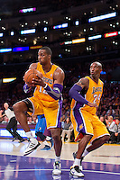30 October 2012: Center (12) Dwight Howard of the Los Angeles Lakers grabs a rebound away from (24) Kobe Bryant against the Dallas Mavericks during the first half of the Mavericks 99-91 victory over the Lakers at the STAPLES Center in Los Angeles, CA.
