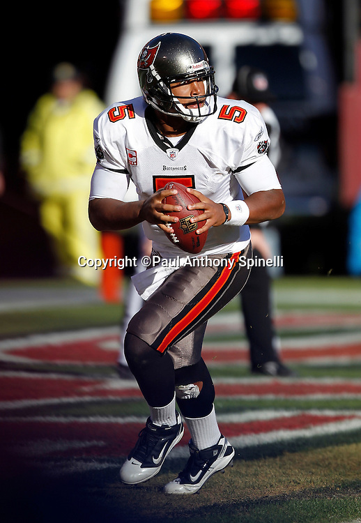Tampa Bay Buccaneers quarterback Josh Freeman (5) rolls out while looking to throw a pass during the NFL week 11 football game against the San Francisco 49ers on Sunday, November 21, 2010 in San Francisco, California. The Bucs won the game 21-0. (©Paul Anthony Spinelli)