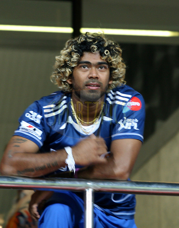 Lasith Malinga of Mumbai Indians watching the award ceremony from the players enclosure after the match 8 of the the Indian Premier League ( IPL ) Season 4 between the Royal Challengers Bangalore and the Mumbai Indians held at the Chinnaswamy Stadium, Bangalore, Karnataka, India on the 12th April 2011..Photo by Vino John/BCCI/SPORTZPICS