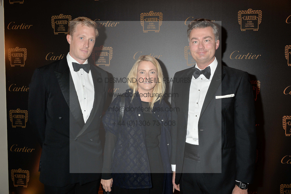 Left to right, CHARLIE & SAM PEARSON and LAURENT FENIOUat the 26th Cartier Racing Awards held at The Dorchester, Park Lane, London on 8th November 2016.