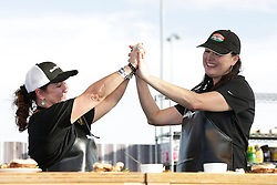 IMAGE DISTRIBUTED FOR SMITHFIELD - BBQ finalists, Chera Little, and Suzanne Clark are seen at the Smithfield Hog Wild Throwdown at the American Royal World Series of Barbecue on Saturday, Oct. 29, 2016 in Kansas City, Kansas. (Colin E. Braley/AP Images for Smithfield)