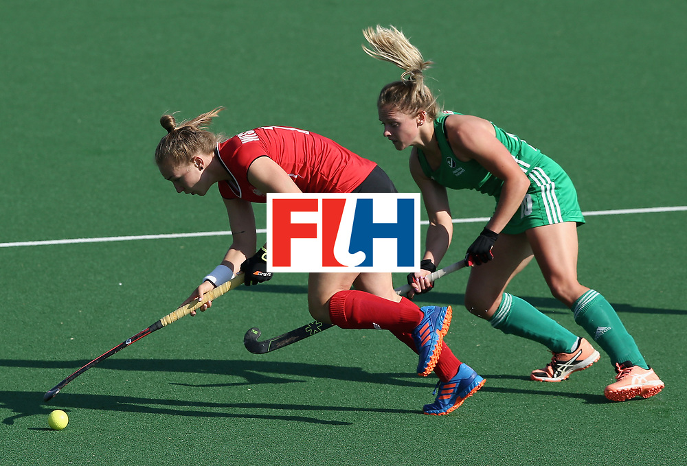 JOHANNESBURG, SOUTH AFRICA - JULY 12: Weronika Wessolowska of Poland and Nicola Evans of Ireland battle for possession during day 3 of the FIH Hockey World League Semi Finals Pool A match between Ireland and Poland at Wits University on July 12, 2017 in Johannesburg, South Africa. (Photo by Jan Kruger/Getty Images for FIH)
