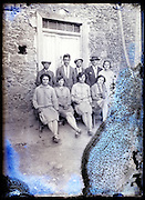young adult couples from the village on a severely eroded glass plate photo