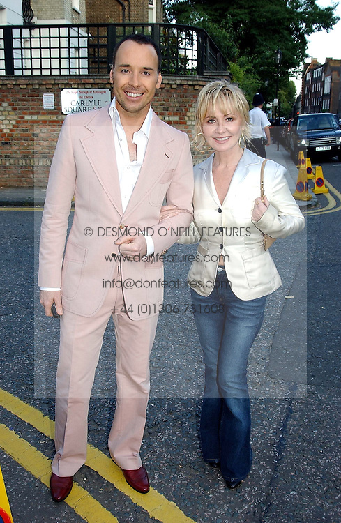 DAVID FURNISH and singer LULU at Sir David & Lady Carina Frost's annual summer party held in Carlyle Square, London on 6th July 2004.