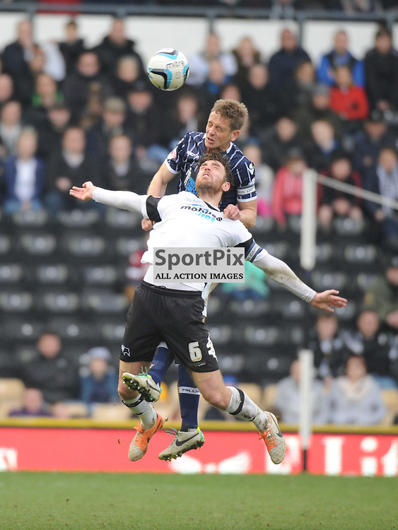 Millwalls Stand in Skipper Paul Robinson, battles with Derbys Richard Keogh, Skipper Derby County v Millwall Sky Bet Championship, Pride Park, Saturday 8th March 2014