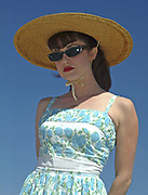 A portrait of a young beautiful woman dressed in 50's style, Viva Las Vegas Festival, Las Vegas, USA 2006.