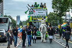 © Licensed to London News Pictures. 16/06/2019. Manchester, UK. A Pakistan supporter arrives at Old Trafford on a white horse . Cricket fans outside Old Trafford Cricket ground where India and Pakistan are due to play in the ICC Cricket World Cup . Photo credit: Joel Goodman/LNP
