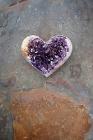 Amythyst stone heart. Amethyst is a meditative and calming stone which works in the emotional, spiritual, and physical planes to promote calm, balance, and peace. It is also used to eliminate impatience.