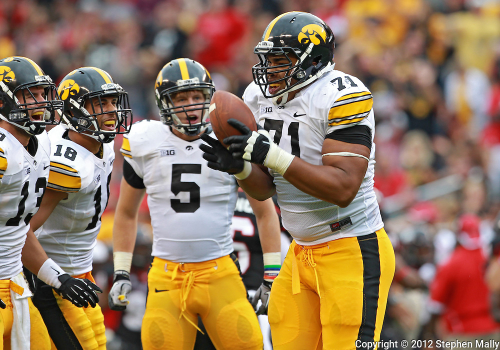 September 01 2012: Iowa Hawkeyes defensive lineman Carl Davis (71) comes up with a fumble during the second half of the NCAA football game between the Iowa Hawkeyes and the Northern Illinois Huskies at Soldiers Field in Chicago, Illinois on Saturday September 1, 2012. Iowa defeated Northern Illinois 18-17.
