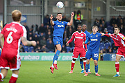 AFC Wimbledon defender Luke O'Neill (2) heading the ball during the EFL Sky Bet League 1 match between AFC Wimbledon and Gillingham at the Cherry Red Records Stadium, Kingston, England on 23 November 2019.