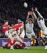 Twickenham, Surrey. UK. Wales, Scrum half, Gareth DAVIES, kicking clear from the back of the scrum, Joe LAUNCHBURY and Courtney LAWES, attempt to charge the ball down, during the Six Nations Rugby Match, England vs Wales RFU Stadium, Twickenham. Surrey, England. on Saturday 10.02.18<br /> <br /> <br /> [Mandatory Credit Peter SPURRIER/Intersport Images]