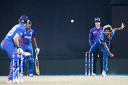 © Licensed to London News Pictures. 01/10/2012. Sri Lankan Lasith Malinga bowling during the T20 Cricket World super 8's match between England Vs Sri Lanka at the Pallekele International Stadium Cricket Stadium, Pallekele. Photo credit : Asanka Brendon Ratnayake/LNP