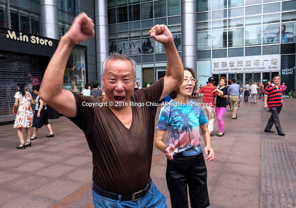 """People dance in front of Brilliance Shimao International Plaza along the Nanjing Road Pedestrian Street on September 5, 2016, in Shanghai, China. Nanjing Road is the main shopping street of Shanghai, China, and is one of the world's busiest shopping streets. The street is named after the city of Nanjing, capital of Jiangsu province neighbouring Shanghai. Today's Nanjing Road comprises two sections, Nanjing Road East and Nanjing Road West. In some contexts, """"Nanjing Road"""" refers only to what was pre-1945 Nanjing Road, today's Nanjing Road East, which is largely pedestrianised. Before the adoption of the pinyin romanisation in the 1950s, its name was rendered as Nanking Road in English. Shanghai is the most populous city in China and the most populous city proper in the world. It is one of the four direct-controlled municipalities of China, with a population of more than 24 million as of 2014. It is a global financial centre, and a transport hub with the world's busiest container port. Located in the Yangtze River Delta in East China, Shanghai sits on the south edge of the mouth of the Yangtze in the middle portion of the Chinese coast. The municipality borders the provinces of Jiangsu and Zhejiang to the north, south and west, and is bounded to the east by the East China Sea. A major administrative, shipping, and trading town, Shanghai grew in importance in the 19th century due to trade and recognition of its favourable port location and economic potential. The city was one of five forced open to foreign trade following the British victory over China in the First Opium War while the subsequent 1842 Treaty of Nanking and 1844 Treaty of Whampoa allowed the establishment of the Shanghai International Settlement and the French Concession. The city then flourished as a center of commerce between China and other parts of the world (predominantly Western countries), and became the primary financial hub of the Asia-Pacific region in the 1930s. However, with the Communist Par"""