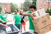 Ohio University student Bianca Baylis (Right) helps fellow students move into their residence halls on East Green. Photo by Ben Siegel/ Ohio Universtiy