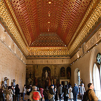 The Gallery Room in the Alcazar of Segovia, Spain features a mural at the far end commemorating the coronation of Queen Isabella.