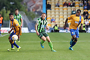 Barry Fuller (Captain) of AFC Wimbledon takes on Malvind Benning during the Sky Bet League 2 match between Mansfield Town and AFC Wimbledon at the One Call Stadium, Mansfield, England on 5 September 2015. Photo by Stuart Butcher.