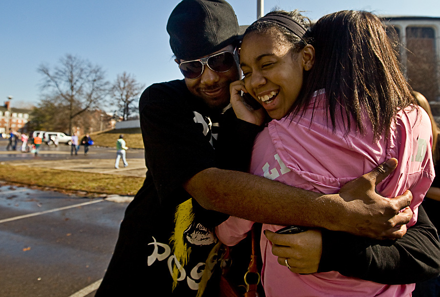(from left) Ricardo Fields and his cousin Alexis Wills, a freshman video production major, hug their cousin Bianca Parsons, from Cleveland Heights, on Sunday, February 8, 2009, in the back of the Convocation Center, as buses prepare to take siblings back to their respective homes.
