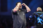 Danny Baggish hits a double and wins his first round match against Andy Boulton during the PDC William Hill World Darts Championship at Alexandra Palace, London, United Kingdom on 15 December 2019.