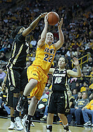 January 28, 2012: Purdue Boilermakers forward Alex Guyton (41) tries to block a shot by Iowa Hawkeyes guard Samantha Logic (22) during the NCAA women's basketball game between the Purdue Boilermakers and the Iowa Hawkeyes at Carver-Hawkeye Arena in Iowa City, Iowa on Saturday, January 28, 2012.