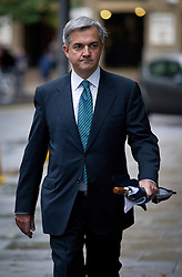 ©  London News Pictures. 01/10/2012. London, UK. Liberal Democrat MP CHRIS HUHNE arriving at Southwark Crown Court in London on October 1, 2012 where he faces charges of perverting the course of justice, for legal argument. The trial of Former Energy Secretary CHRIS HUHNE and his ex-wife VICKY PRYCE is due to start tomorrow (Tues). HUHNE is accused of asking his ex-wife VICKY PRYCE to take speeding points on his behalf in 2003. Photo credit : Ben Cawthra/LNP