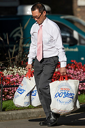 © Licensed to London News Pictures. 22/07/2019. London, UK. An aide is seen carrying bags from Tesco supermarket ahead of Prime Minister Theresa May's farewell drinks reception at Downing Street.  Voting in the Conservative party leadership election ends today with the results to be announced tomorrow. Photo credit: Peter Macdiarmid/LNP