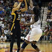 Jennifer Lacy, Tulsa Shock, shoots past Chiney Ogwumike, Connecticut Sun,  during the Connecticut Sun Vs Tulsa Shock WNBA regular season game at Mohegan Sun Arena, Uncasville, Connecticut, USA. 3rd July 2014. Photo Tim Clayton